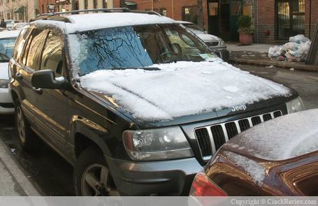 Snow covered automobile
